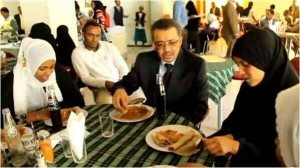 "Photo from Dr. Tedros facebook page, Nov. 25, 2013. Captioned: ""Having lunch with citizens deported from Saudi. They are upbeat."""