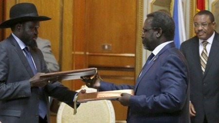 President Salva Kiir and rebel leader Riek Machar and Ethiopian PM Hailemariam Desalegn - at the peace deal signing in Addis Ababa