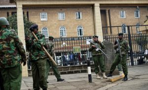 Photo - Officers outside the Supreme Court building in Nairobi, Kenya, on Friday