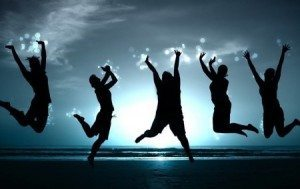 Image - Three people jumping and sunset