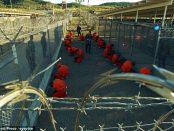Photo - Taliban and al-Qaida suspects in orange jumpsuits at Guantanamo Bay prison complex [Credit: Zuma press/eyevine]