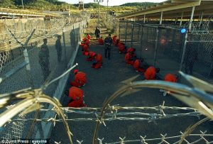 Photo - Taliban and al-Qaida suspects in orange jumpsuits at Guantanamo Bay prison complex [Credit: Zuma press/eyevine]