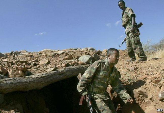 Photo - Ethiopian soldiers emerge from a trench on a hilltop overlooking the northern Ethiopian [Credit: AFP, 2005]