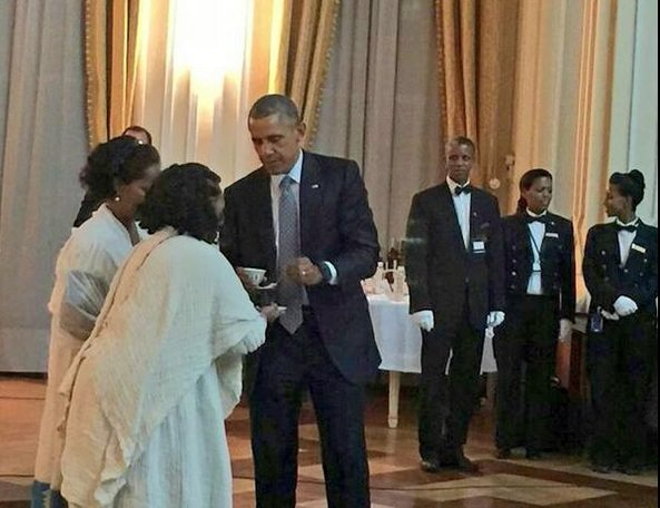 Photo - President Obama at Ethiopian National palace, women in traditional dress serving coffee