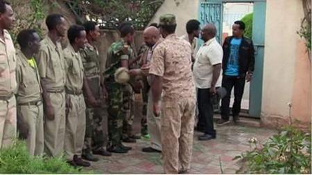 Photo - Berhanu Nega greeting his troops in Eritrea july 2015
