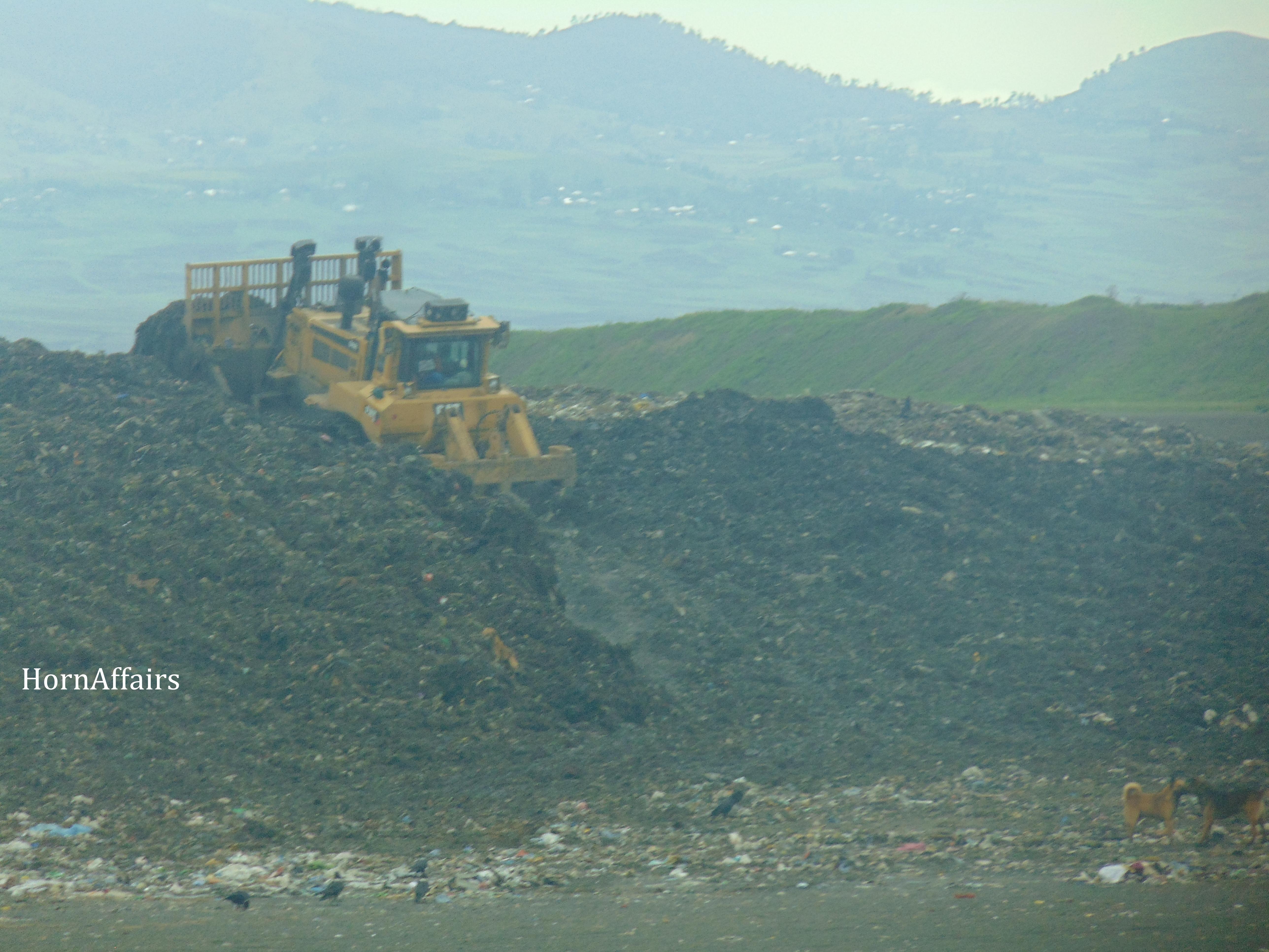 Photo - Sendafa Landfill, A truck pushing the pile of trash