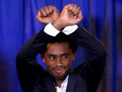 Photo - Olympian Feyisa Lilesa making Oromo protest gesture in Washington, DC [Credit: Reuters]