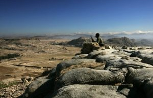 Photo - An Ethiopian soldier mans an observation post on the Eritrean border on 19 November 2005. [AFP - Marco Longari]