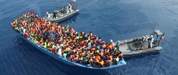 Photo - Migrants on boat on Mediterranean Sea