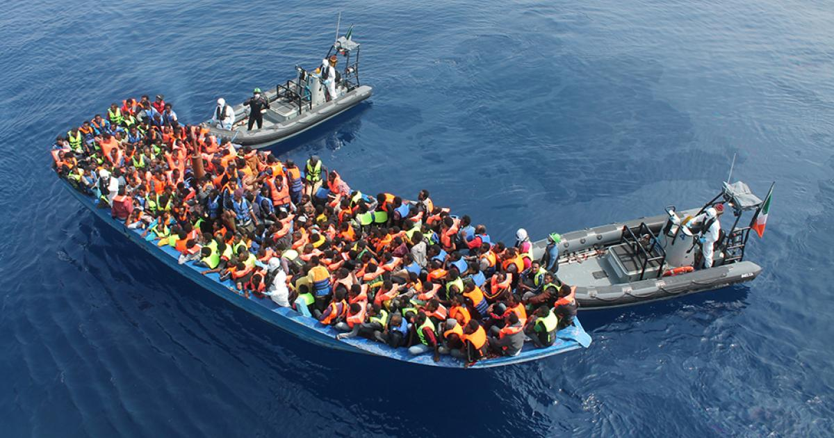 Photo - Migrants on boat on Mediterranean Sea