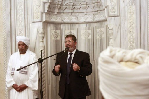 Mohamed Morsi speaks at the al-Nour mosque Khartoum on Friday. Egypt's President Mohamed Morsi said during his first visit to Sudan that cooperation between the Islamist regimes in Cairo and Khartoum